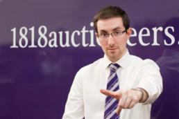 Business portrait auctioneer